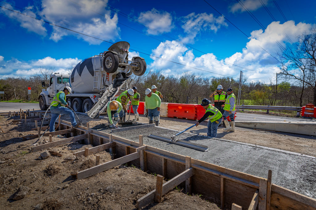 image of concrete contractor crew pouring a city sidewalk