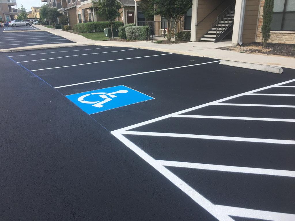 Asphalt striping and handicap parking symbol