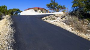 Asphalt drivway leading to house in the Texas Hill Counrty