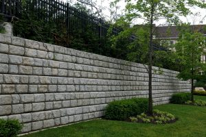 Interlocking CMU blocks retaining wall landscape