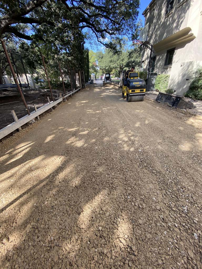 Image of base material being compacted throughout driveway