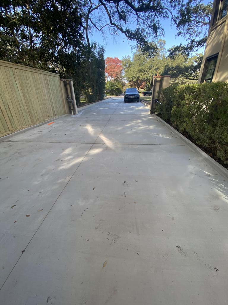 After image of poured residential concrete driveway