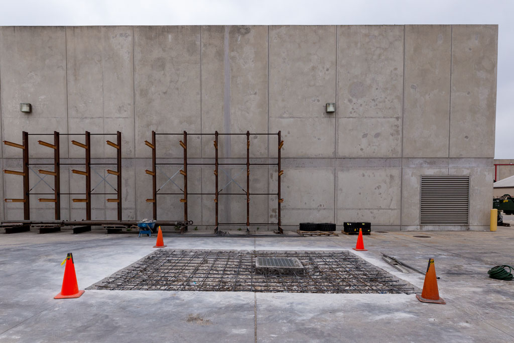 Image of an industrial driveway in which concrete is to be poured around a storm drain