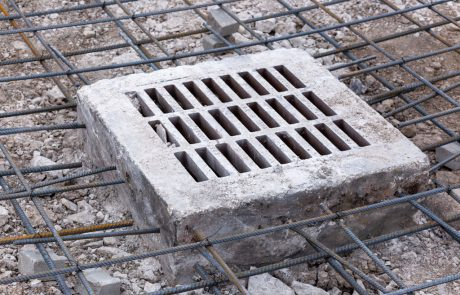Image of a double mat layer of tied rebar around a concrete storm drain