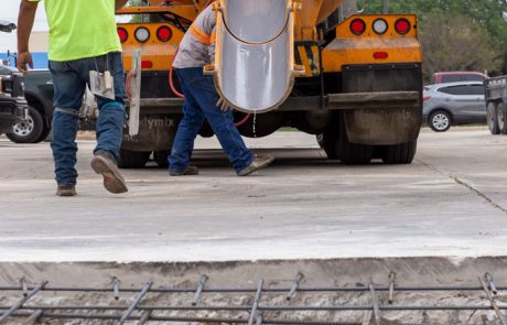 Image of concrete truck backing up to pour concrete